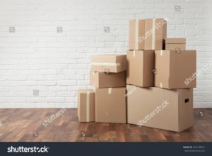 Several moving boxes in an empty room
