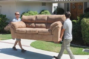 Spry Movers Employees Moving Couch