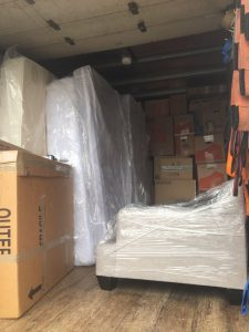 Moving Truck Packed with Furniture and Boxes